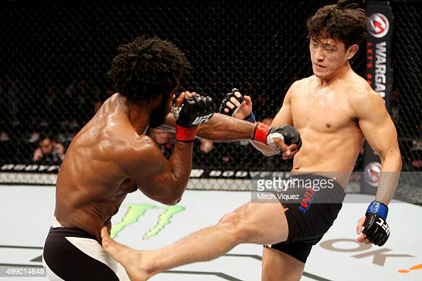 Dong Hyun Kim of South Korea kicks Dominique Steele of the United States of America in their lightweight bout during the UFC Fight Night at the...