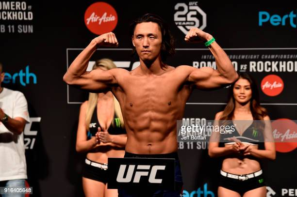 Dong Hyun Kim of South Korea poses on the scale during the UFC 221 weigh-in at Perth Arena on February 10, 2018 in Perth, Australia.