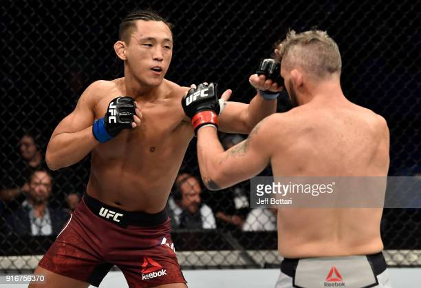 Dong Hyun Kim of South Korea punches Damien Brown of Australia in their lightweight bout during the UFC 221 event at Perth Arena on February 11, 2018...