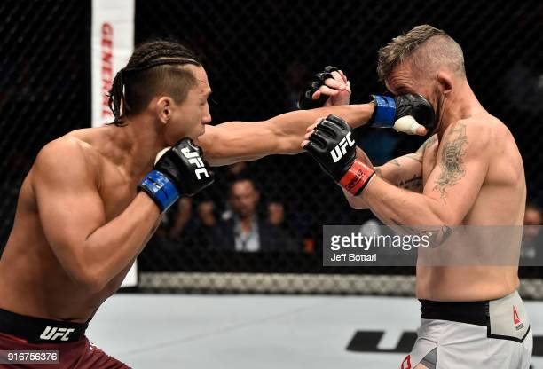 Dong Hyun Kim of South Korea punches Damien Brown of Australia in their lightweight bout during the UFC 221 event at Perth Arena on February 11 2018...