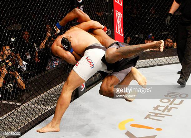 Dong Hyun Kim of South Korea takes down Dominic Waters of the United States of America grapple for control in their welterweight bout during the UFC...