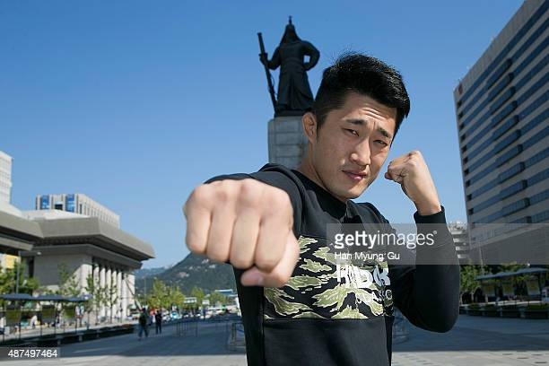 Dong Hyun Kim poses in front of a statue of Admiral Lee Soon-Shin on September 10, 2015 in Seoul, South Korea.