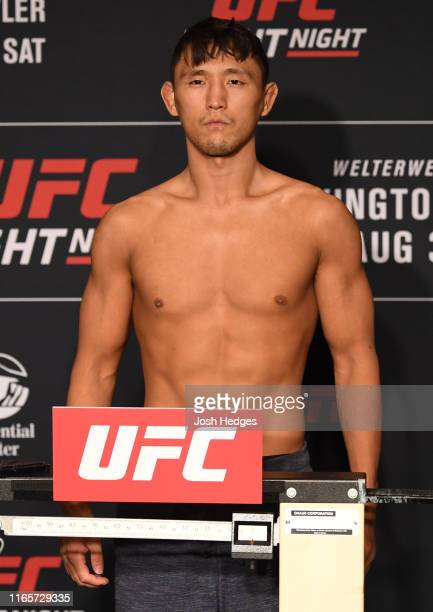 Dong Hyun Ma of South Korea poses on the scale during the UFC Fight Night official weigh-in at the DoubleTree Hotel on August 02, 2019 in Newark, New...
