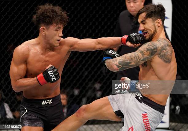 Dong Hyun Ma of South Korea punches Omar Morales of Venezuela in their lightweight fight during the UFC Fight Night event at Sajik Arena 3 on...