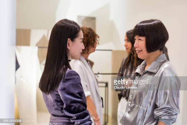 Dong Jie and Angelica Cheung are seen at the Brunello Cucinelli presentation during Milan Fashion Week Spring/Summer 2019 on September 19 2018 in...