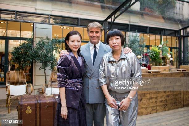 Dong Jie Brunello Cucinelli and Angelica Cheung are seen at the Brunello Cucinelli presentation during Milan Fashion Week Spring/Summer 2019 on...