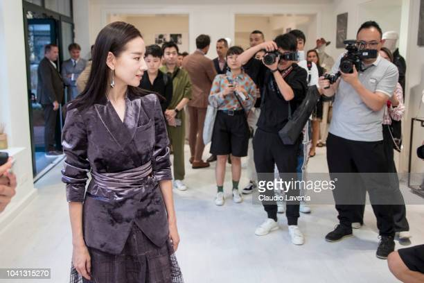 Dong Jie is seen at the Brunello Cucinelli presentation during Milan Fashion Week Spring/Summer 2019 on September 19 2018 in Milan Italy