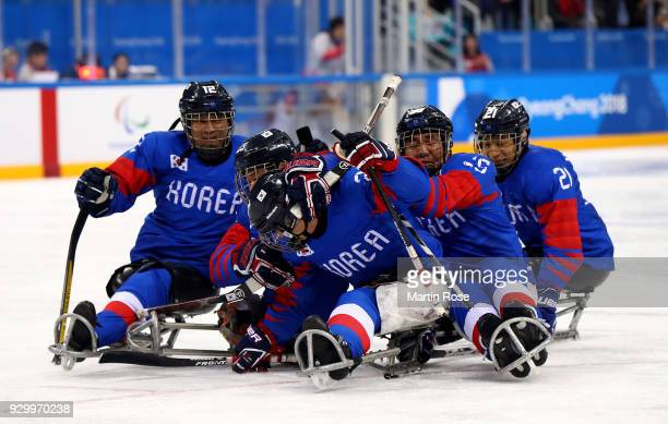 Dong Shin Jang of Korea celebrates after he scores the opening goal in the Ice Hockey Preliminary Round Group B game between South Korea and Japan...