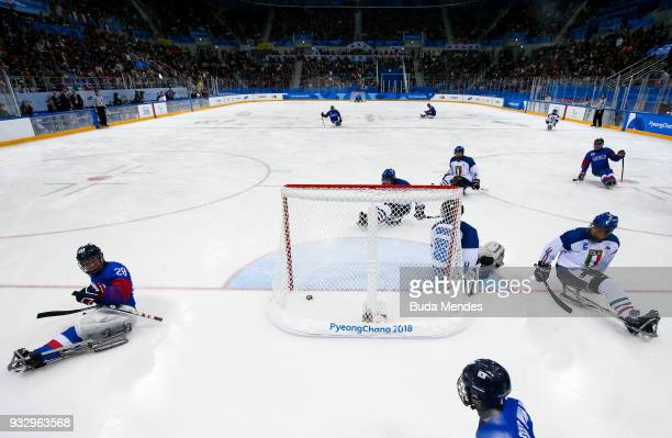 Dong Shin Jang of Korea scores the goal over Italy in the Ice Hockey bronze medal game between Korea and Italy during day eight of the PyeongChang...