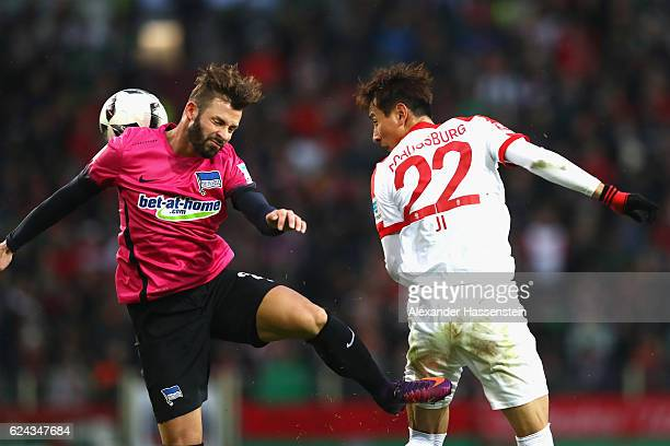 Dong Won Ji of Augsburg battles for the ball with Marvin Plattenhardt of Berlin during the Bundesliga match between FC Augsburg and Hertha BSC at WWK...
