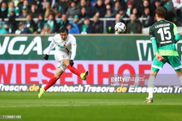 Dong Won Ji of Augsburg battles for the ball with Sebastian Langkamp of Bremen during the Bundesliga match between SV Werder Bremen and FC Augsburg...