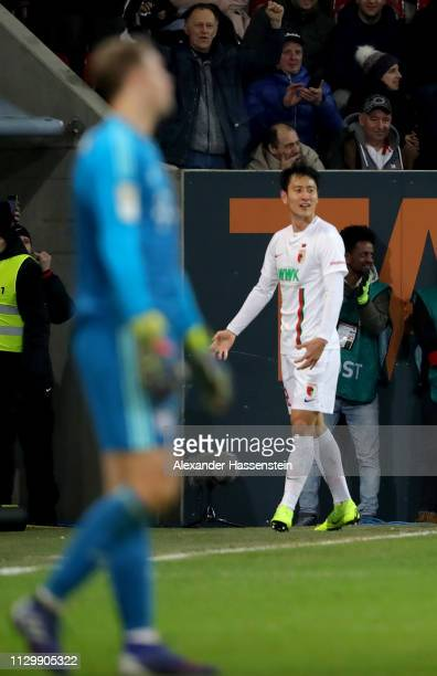 Dong Won Ji of Augsburg celebrates after he scores the 2nd goal during the Bundesliga match between FC Augsburg and FC Bayern Muenchen at WWKArena on...