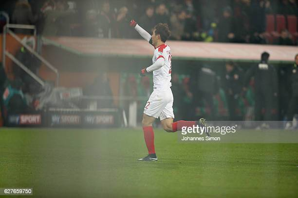 Dong Won Ji of Augsburg celebrates after scoring his team's first goal during the Bundesliga match between FC Augsburg and Eintracht Frankfurt at WWK...