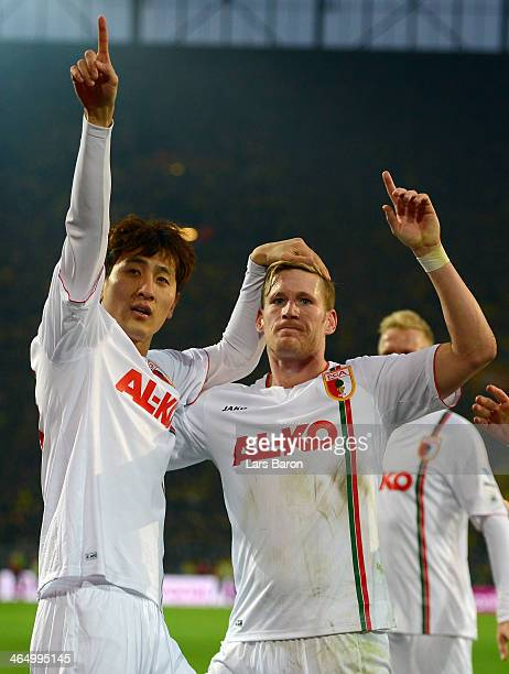 Dong Won Ji of Augsburg celebrates after scoring his teams second goal during the Bundesliga match between Borussia Dortmund and FC Augsburg at...