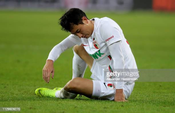 Dong Won Ji of Augsburg looks dejected after the Bundesliga match between FC Augsburg and FC Bayern Muenchen at WWK-Arena on February 15, 2019 in...