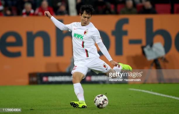 Dong Won Ji of Augsburg scores the 2nd goal during the Bundesliga match between FC Augsburg and FC Bayern Muenchen at WWK-Arena on February 15, 2019...