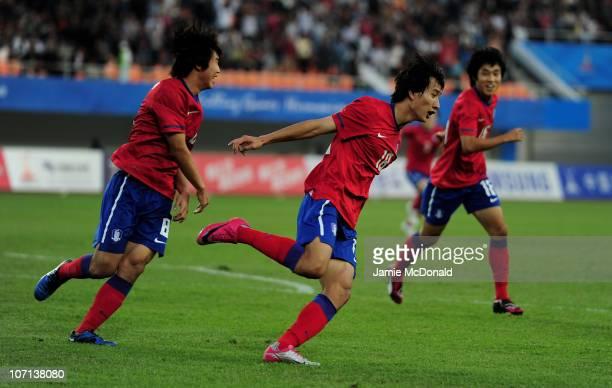 Dong Won Ji of South Korea celebrates scoring the winning goal in the Men's Bronze Medal between South Korea and Iran at Tianhe Stadium during day...