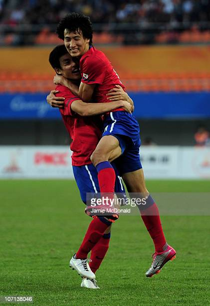 Dong Won Ji of South Korea celebrates scoring the winning goal with Ja Cheol Koo of South Korea in the Men's Bronze Medal between South Korea and...