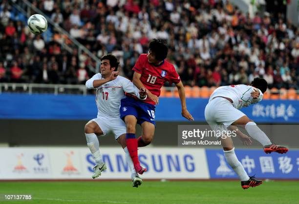 Dong Won Ji of South Korea heads the winning goal in the Men's Bronze Medal between South Korea and Iran at Tianhe Stadium during day thirteen of the...