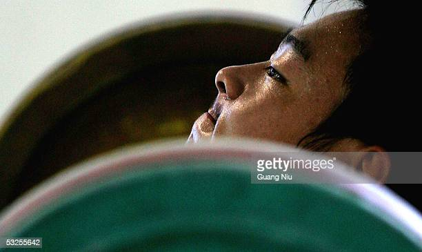 Dong Yingnan trains during a weightlifting course at a Sports School in the Dongcheng District on July 19 2005 in Beijing China The school was...