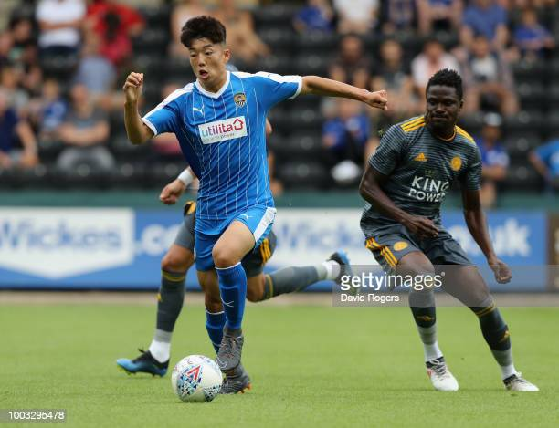 Dongda He of Notts County and Islam Slimani of Leicester City during the preseason match between Notts County and Leicester City at Meadow Lane on...