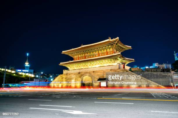 Dongdaemun Gate at night with light trails of Traffic in Seoul city, South Korea