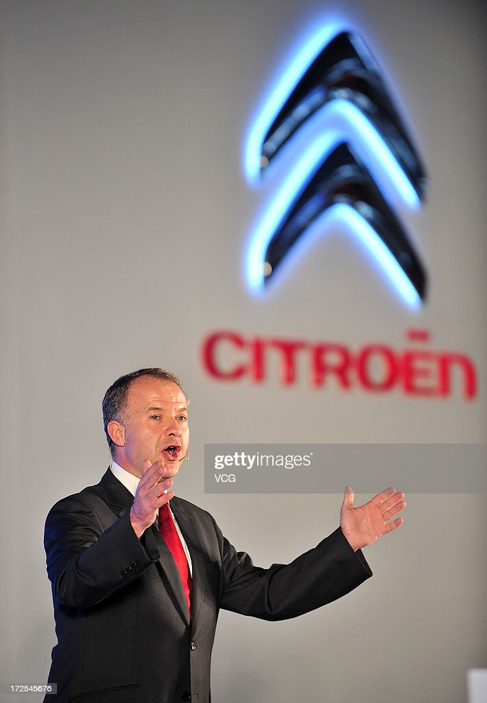 Dongfeng Peugeot Citroen Executive Vice President Jean Mouro speaks during the opening ceremony of the third plant of Dongfeng Peugeot Citroen Automobile Co., Ltd (DPCA) on July 2, 2013 in Wuhan, China. The third plant of DPCA, a joint venture between the French automaker PSA Peugeot Citroen and the Chinese automaker Dongfeng Motor Corp., was put into operation on July 2, with initial capacity of 150,000 cars a year.