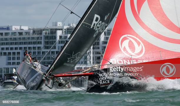 Dongfeng Race Team and Sun Hung Kai/Scallywag head out of Waitamata Harbour after the start of the seventh leg of the Volvo Ocean Race yacht race in...