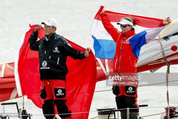 Dongfeng Race Team of China Chinese bowman Chen Horace Jinhao and Dutch trimmer Carolijn Brouwer celebrate after winning the Volvo Ocean Race in...