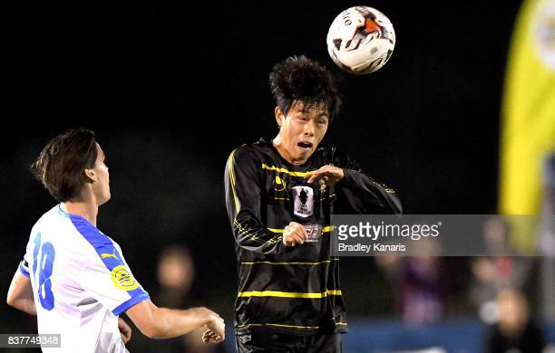 Donggyu Lee of Moreton Bay heads the ball during the FFA Cup round of 16 match between Moreton Bay United and Gold Coast City at Wolter Park on...