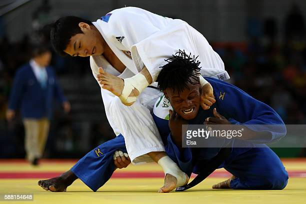 Donghan Gwak of Korea competes against Popole Misenga of the Refugee Olympic Team during a Men's -90kg bout on Day 5 of the Rio 2016 Olympic Games at...