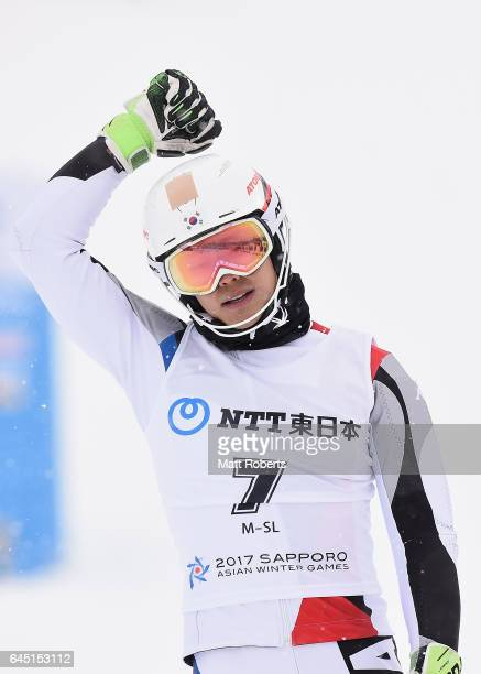 Dong-hyun Jung of Korea celebrates first place in men's slalom alpine skiing on the day eight of the 2017 Sapporo Asian Winter Games at Sapporo Teine...