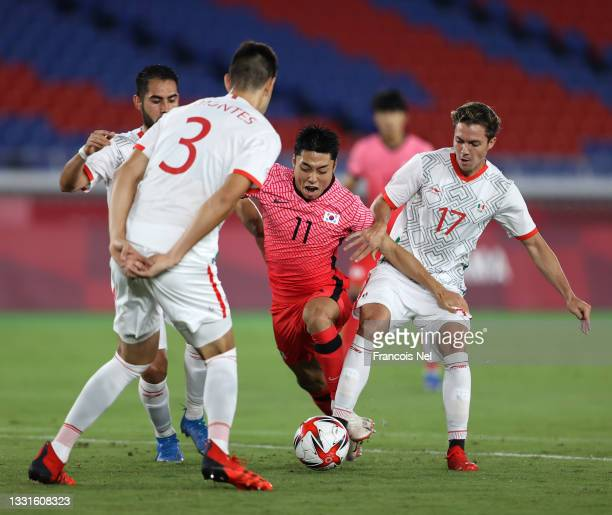 Dongjun Lee of Team South Korea is challenged by Sebastian Cordova of Team Mexico during the Men's Quarter Final match between Republic Of Korea and...