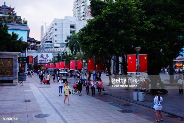 Dongmen Square area with Chinese Flags, Dusk, Shenzhen, China