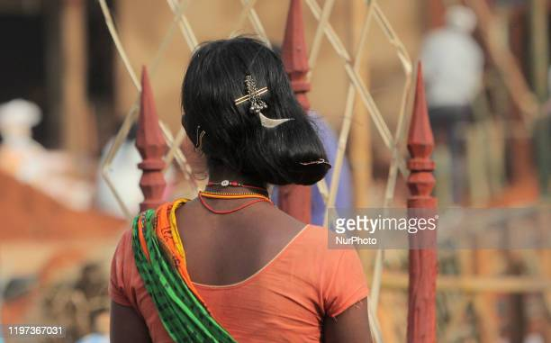 Dongria caste tribes are seen in their traditional attire and built their traditional living house in the national tribal fair in the eastern Indian...