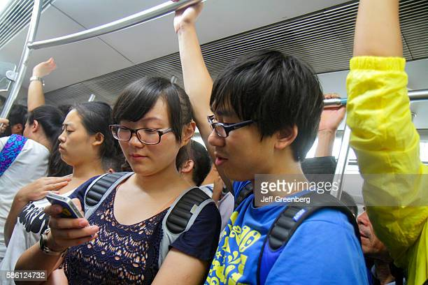 Dongsi Subway Station Line 5 6 Asian woman man passenger standing on crowded train