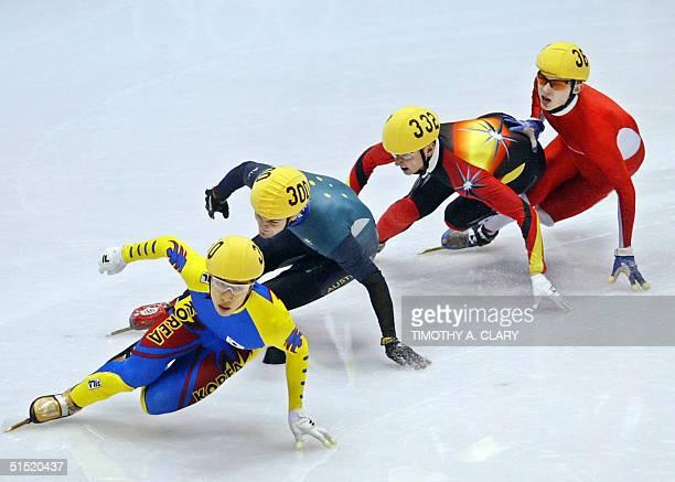 DongSung Kim of South Korea Australian Steven Bradbury German Andre Hartwig and Polish Krystian Zdrojkowski skate during the mens 1500m short track...