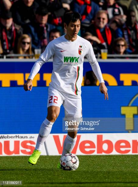 DongWon Ji of Augsburg controls the ball during the Bundesliga match between SportClub Freiburg and FC Augsburg at SchwarzwaldStadion on February 23...
