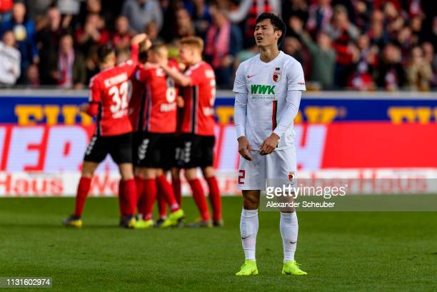 DongWon Ji of Augsburg is disappointed during the Bundesliga match between SportClub Freiburg and FC Augsburg at SchwarzwaldStadion on February 23...