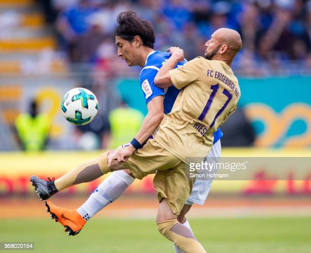 DongWon Ji of Darmstadt is challenged by Philipp Riese of Aue during the Second Bundesliga match between SV Darmstadt 98 and FC Erzgebirge Aue at...