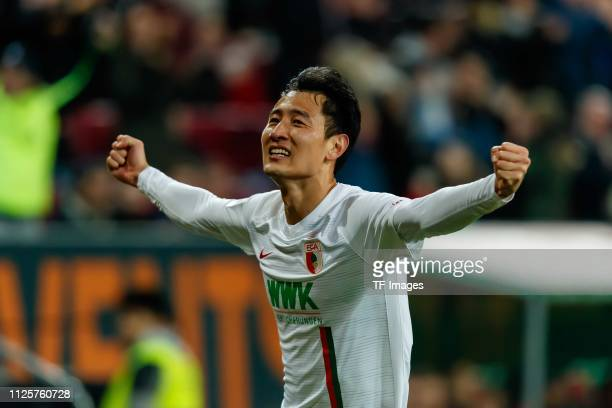 Dongwon Ji of FC Augsburg celebrates after scoring his team's second goal during the Bundesliga match between FC Augsburg and FC Bayern Muenchen at...