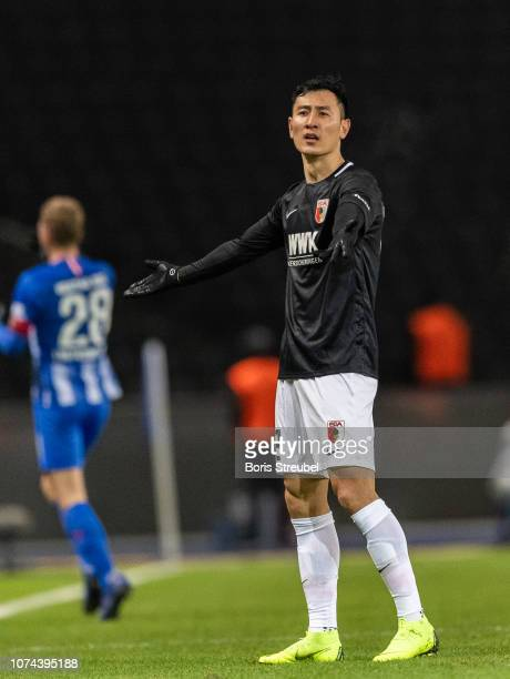 DongWon Ji of FC Augsburg gestures during the Bundesliga match between Hertha BSC and FC Augsburg at Olympiastadion on December 18 2018 in Berlin...