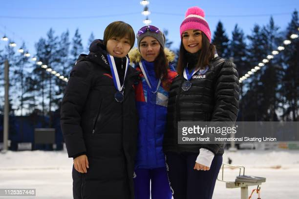 Dongxue Xi of China with the bronze medal Veronika Suslova of Russia with the gold medal and Linda Rossi of Italy with the silver medal celebrate...