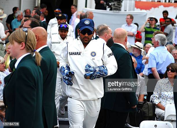 Donhi of India emerges after tea after allowing Ian Bell of England to be re instated in the spirit of the game after being given run out on the...