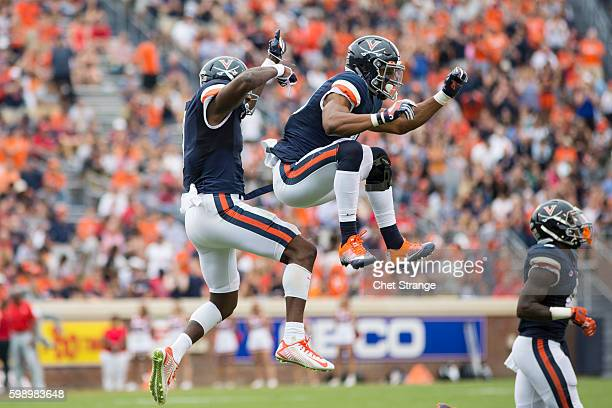 Doni Dowling of the Virginia Cavaliers and Andre Levrone of the Virginia Cavaliers celebrate after a touchdown pass during a game at Scott Stadium on...