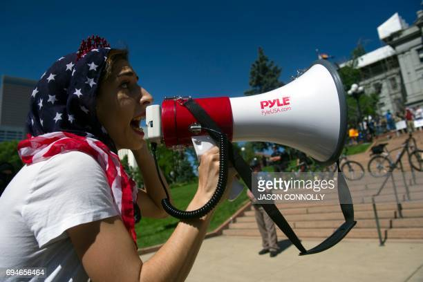 Donia Hanaeia MuslimAmerican from Boulder Colorado engages counterdemonstrators during the Denver March Against Sharia Law in Denver Colorado on June...