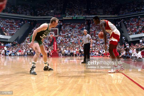 Doninique Wilkins of the Atlanta Hawks squares off against Larry Bird of the Boston Celtics during the 1987 NBA game at the Omni in Atlanta Georgia...