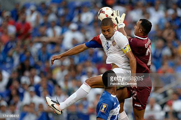 Donis Escober of Hunduras makes a save as he collides with Alvaro Saborio of Costa Rico in the first half during the 2013 CONCACAF Gold Cup...