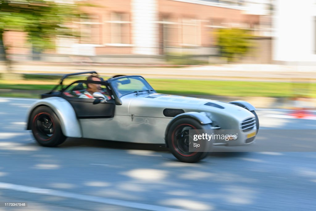 Donkervoort lightweight Dutch sports car driving at high speed on a road through a forest : Stock Photo