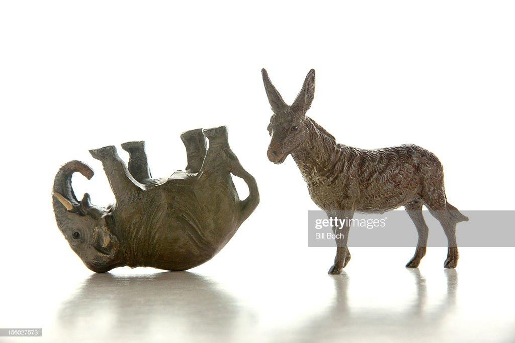 Donkey and defeated elephant miniatures : Stock Photo